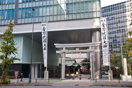 TOKYO, JAPAN - DECEMBER 1, 2018: Toranomon Kotohiragu Shrine at Minato district, which is one of the busiest business district of Tokyo. The Shinto shrine is surrounded by modern office buildings and commercial skyscrapers. The shrine is believed to bring