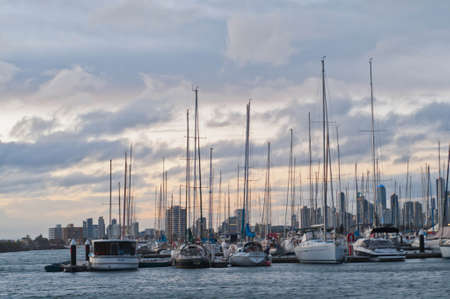 MELBOURNE, AUSTRALIA - JULY 29, 2018: Various ships and private yachts parked at St. Kilda pier bay in Melbourne Victoria Australia in the afternoon. Nobody is in the photo.