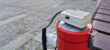 Red electronic megaphone speaker for protestor lays outdoor 写真素材