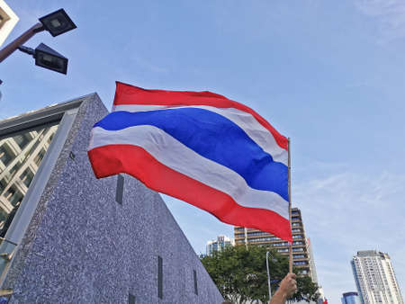 BRISBANE, AUSTRALIA - NOVEMBER 29, 2020: Group of protestors shows Thailand national flag while peacefully rally at King George Square, City Hall, in Brisbane Australia to protest the dictatorship of the prime minister Prayuth Chan-ocha in Thailand and al
