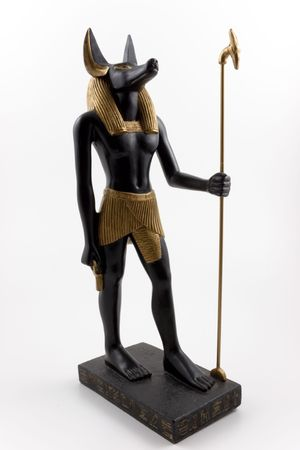 anubis: Statue of Anubis in Human Form against a white background