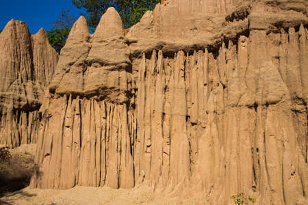 eroded: Mountain of pillar soil with blue sky, Thailand