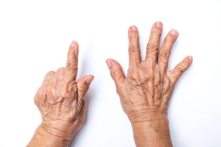 Senior woman's hands counting 7 isolated on white background, Numbers 1-10 in sign language concept