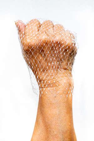 Senior woman's hands wear plastic net bag on white background