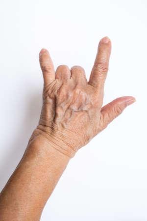 Senior womans hand symbol mean  I love you