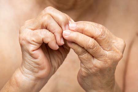 Senior woman nibbling nails, Close up, Body language feeling Banque d'images