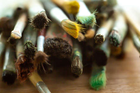 Old, Dirty Paint Brushes on wood table ground, Close up & Macro shot, Selective focus, Stationery concept 스톡 콘텐츠