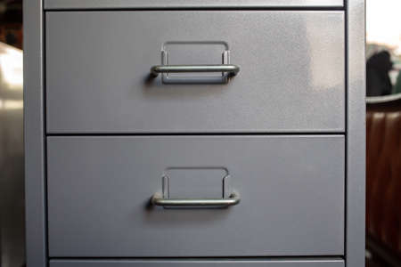 Filing cabinet with closed drawer, Grey silver metal colour, Administration and storage concept, closeup & Macro shot Stockfoto