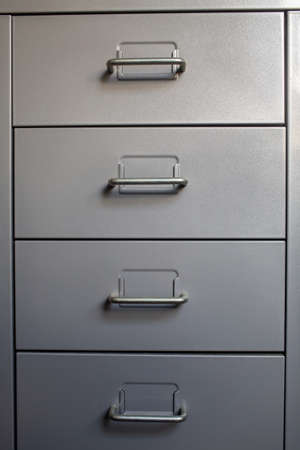 Filing cabinet with closed drawer, Grey silver metal colour, Administration and storage concept