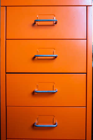 Filing cabinet with closed drawer, Orange metal colour, Administration and storage concept Stockfoto