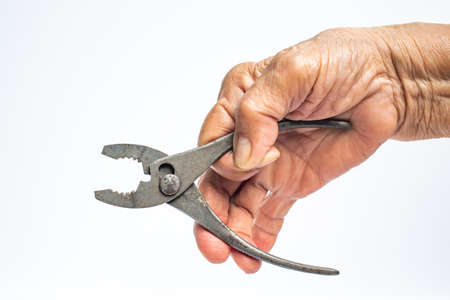 Senior Woman's right hand holding silver metal pliers on white background, Construction building and repair tool concept