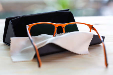Eyeglasses with microfibre cleaning cloths in black box, Close up & Macro shot, Selective focus