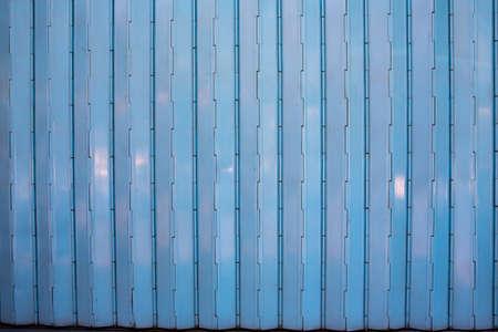 Closed grey mix blue steel door stretch with shutter door Stockfoto