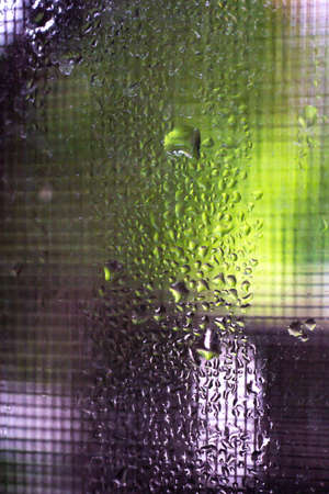Rain drops, Water drops on mirror in bokeh green garden background, Close up & Macro shot, Selective focus, About Morning, Rainy day concept