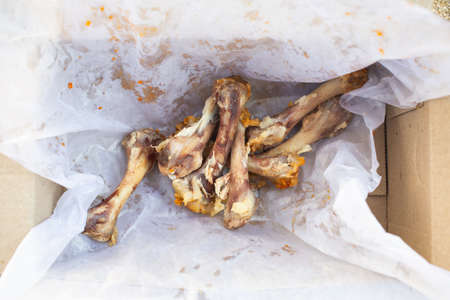 Seven Chicken Bones in Leg with white facial papers in  the box, Abstract background
