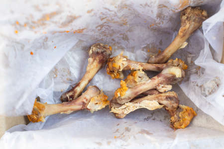 Seven Chicken Bones in Leg with white facial papers in  the box, Abstract background Stok Fotoğraf - 129308657