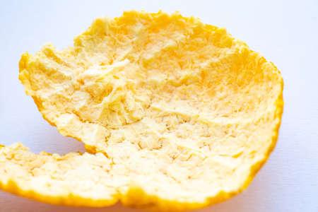 Orange fruit peel on white background, Close up and macro shot, Selective focus Stock Photo