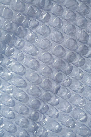 Plastic Bubble Cushioning Wrap surface texture on white background, Light & Shadow concept