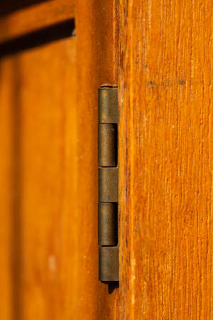 Table hinge on wooden table, Close up & Macro shot, Selective focus