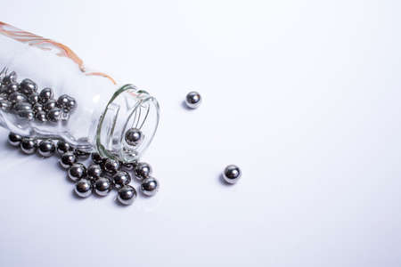 Metal sphere or steel balls in the bottle isolated on white background