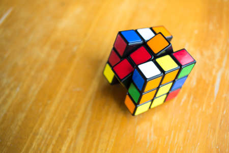 Bangkok, Thailand, 17 march 2018, Rubiks cube  on wood texture background, Rubiks cube invented by a Hungarian architect Erno Rubik in 1974 Publikacyjne