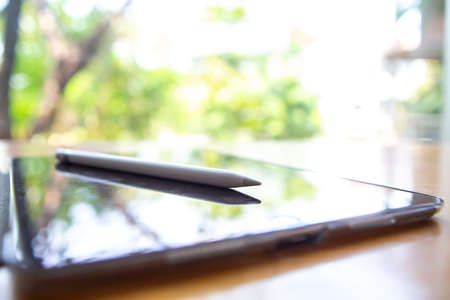 Bangkok Thailand - March 02, 2019 : Blurred Apple pencil with Black tablet computers iPad Pro on wood table, Technology, Business concept, iPad Pro 10.5 inch was created and developed by the Apple inc. Publikacyjne
