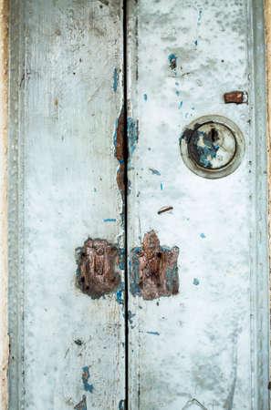 Old rusty metal lock with old wooden door, closeup