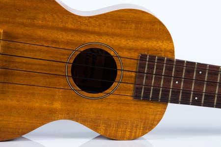 Ukulele guitar isolated on white background Zdjęcie Seryjne - 129765915