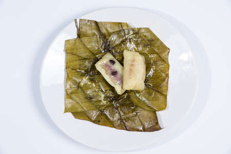 Traditional Thai food style, Banana with sticky rice on white background (Khao Tom Mat or Khao Tom Pad )