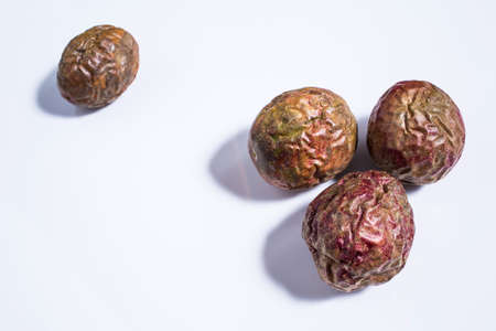 Passion fruit rotten isolated on white background