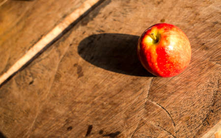 Red apple on wood background
