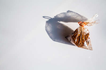 Cayenne pepper in plastic bag isolated on white background Zdjęcie Seryjne