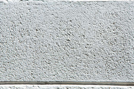 Rough bricks concrete wall, Cement texture, White painted colour background, Close up shot Zdjęcie Seryjne