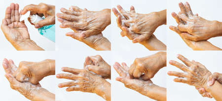 Senior woman's hands washing her hands using soap foam step in step on white background, Close up & Macro shot, Selective focus, Prevention from covid19, Bacteria, healthcare concept, 7 steps wash hand Foto de archivo
