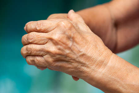 Senior woman's touching her hands and praying, Close up & Macro shot, Selective focus, Asian Body skin part, Body language feeling, Religious concept Zdjęcie Seryjne