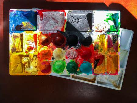 Dry acrylic colour texture on palette background, Close up shot, About Paint concept