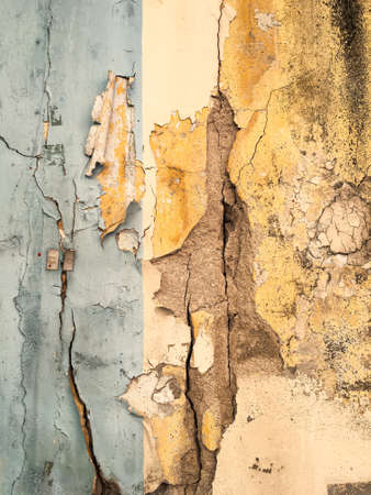 Abstract cracked and peeled concrete texture background, Yellow and blue painted colour, Close up shot, Interior home concept Zdjęcie Seryjne