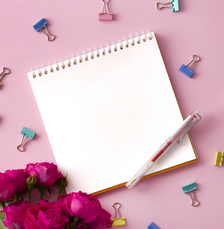 Flat lay picture with blank open notepad and different accessories on colored surface. Фото со стока