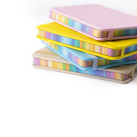 Colorful notebooks isolated on white background. Back to school concep with copy space