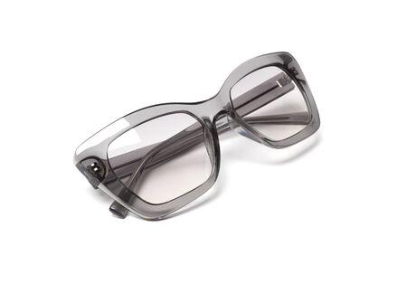 Modern fashionable sunglasses isolated on white background. Fashion blogger concept Reklamní fotografie