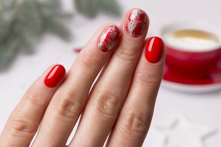 Christmas New Year manicure abstract nail design. Beautiful manicured woman's hand over home office table. Imagens