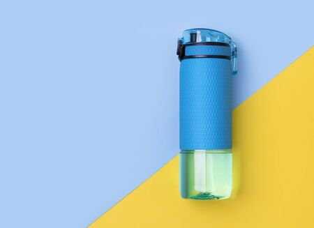 Blue bottle of water. Sport beverage on creative background. Stok Fotoğraf