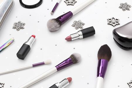 Womens accessories, cosmetics and makeup tools with Christmas decorations on a white background. Winter beauty fashion concept concept