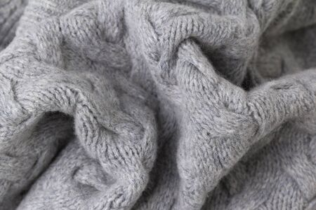 Texture of gray knitted fabric close up. Wool knitwear. Winter autumn sweater design Zdjęcie Seryjne
