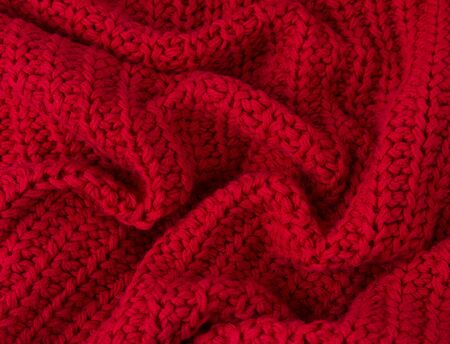Texture of red knitted fabric close up. Wool knitwear. Winter autumn sweater design Zdjęcie Seryjne