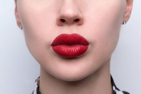 Close up beautiful womans plump sexy full lips with red lipstick