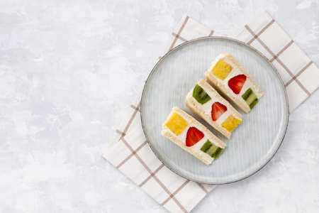 Japanese style sweet fruits sandwich with strawberry, pineapple and kiwi. Sweet homemade summer breakfast