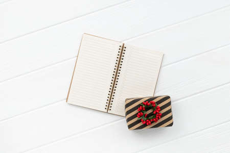 Christmas present over white wooden background. Minimalist eco friendly zero waste new year composition. 免版税图像