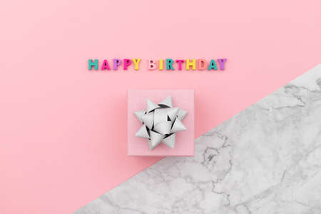 Happy birthday inscription from wooden colorful letters with gift box 免版税图像