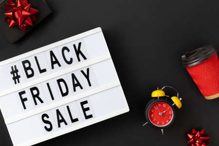 Creative top view flat lay promotion composition with Black friday sale text on lightbox. Template banner shopping sale mockup